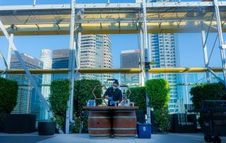Barrel bar set with beautiful bartender by Party Shakers LA | bartending service in Los Angles